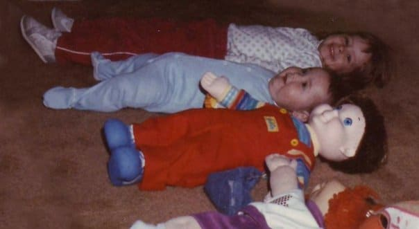 Lining up myself and my brother with my dolls. Yes, I was strange.