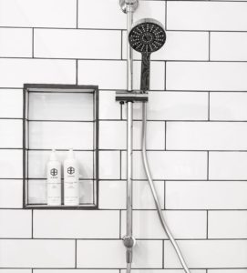 Don't neglect to clean the shower head and curtain